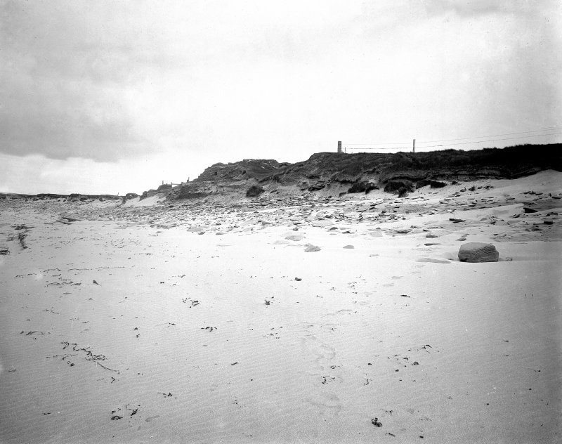 Exterior of settlement from beach.
