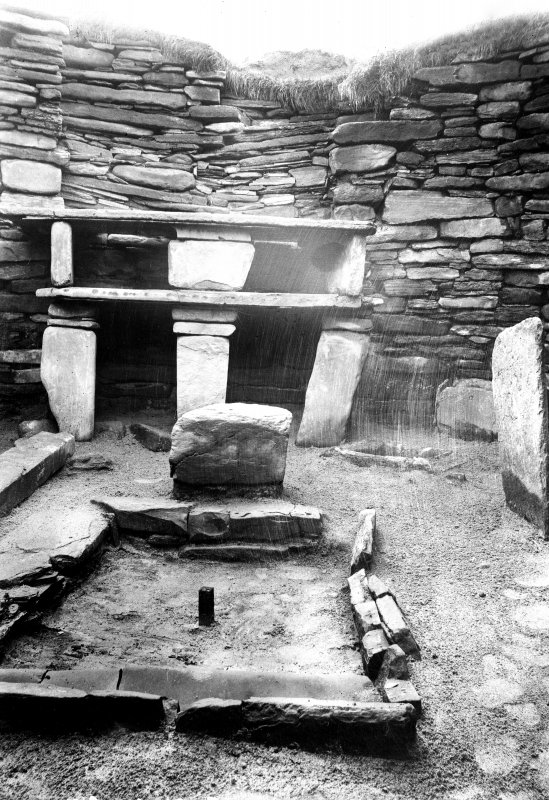 Interior of house 7.  Hearth and dresser.