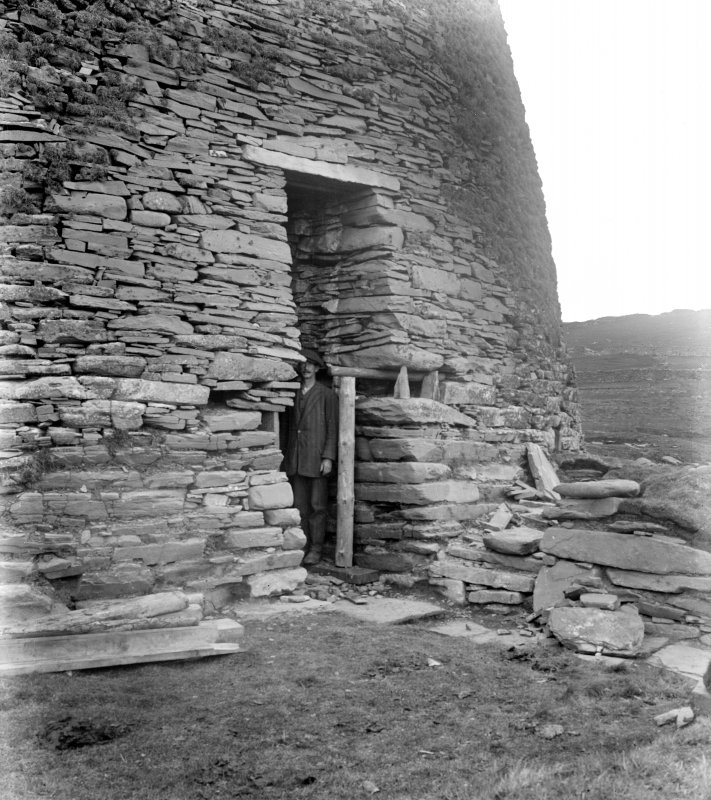 View of altered entrance, Mousa Broch with standing figure.
