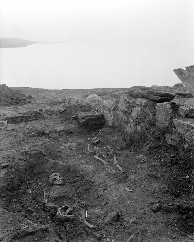 View of skeletons uncovered outside chapel.