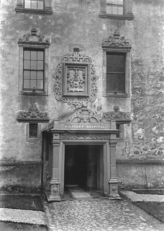 Detail of E range porch and heraldic panel.