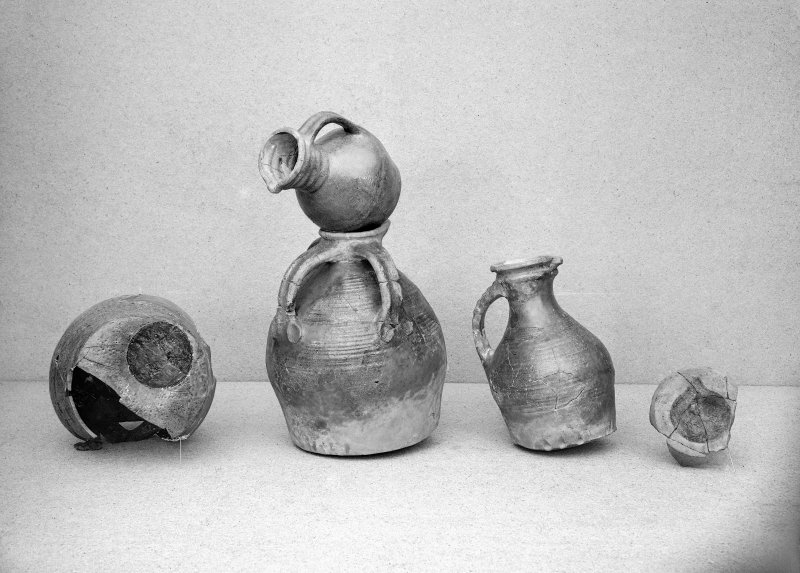 View of five pottery vessels.