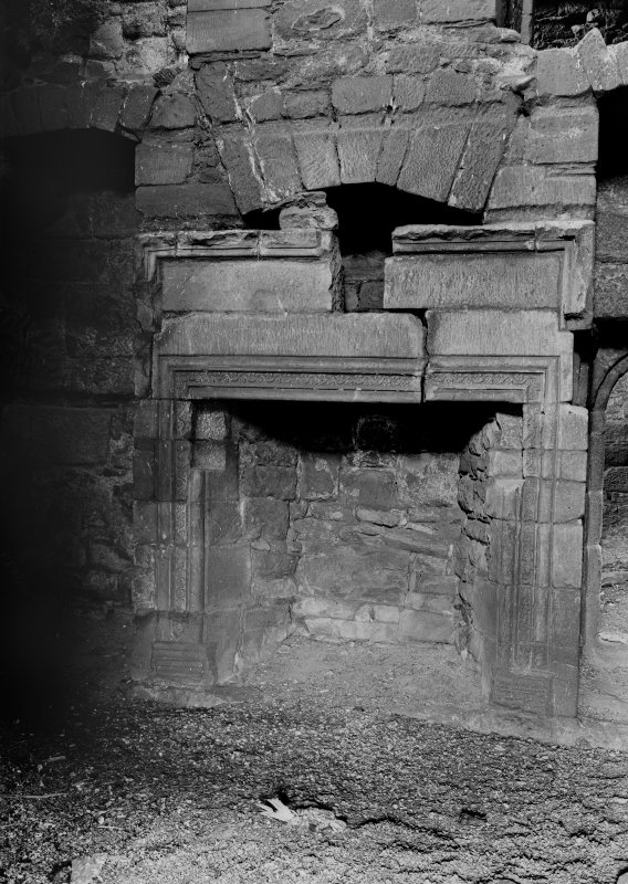 Interior. View of fireplace in wing.