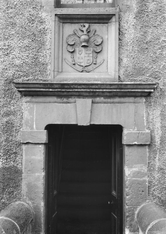 Detail of doorway with coat of arms above.