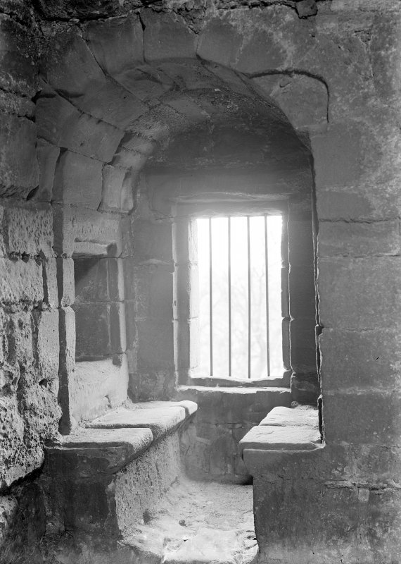 Interior. View of window with stone benches on second floor wing.