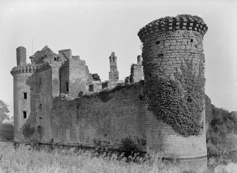 Caerlaverock Castle. View of W curtain and base tower from SW.