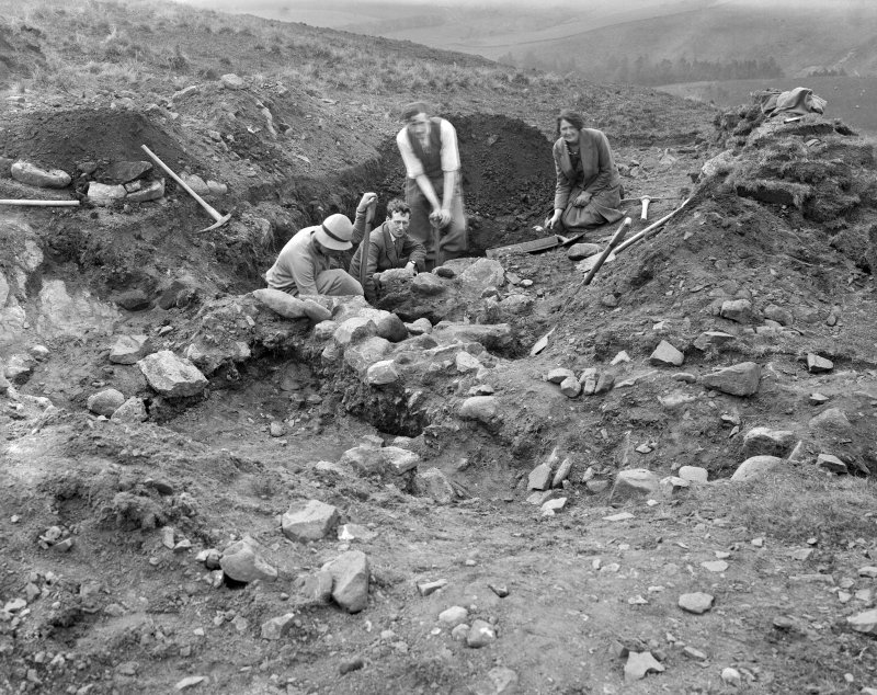 Excavation photograph: people in trench.