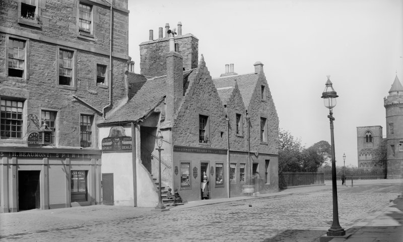 View of Abbey Sanctuary, Edinburgh. Album page titled: 'Abbey Strand (Lucky Spence's House)' Original negative envelope captioned: 'Old House Foot of Canongate'