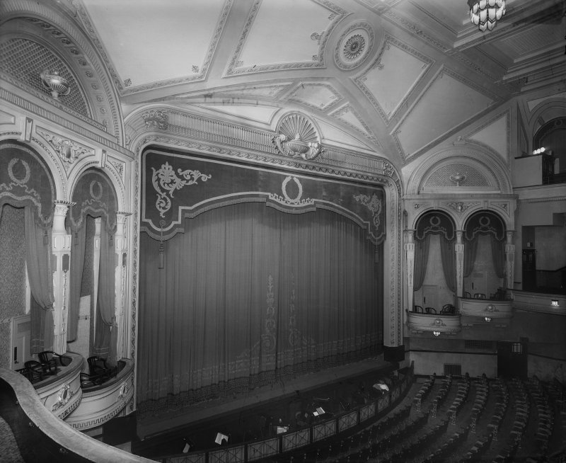 Interior. View of auditorium and stage with curtain closed.