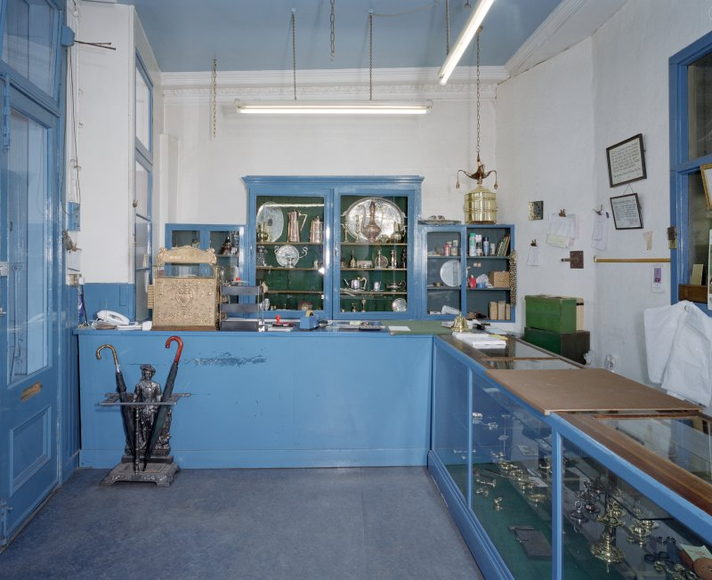 Interior. Ground floor. View of shop front from SW
