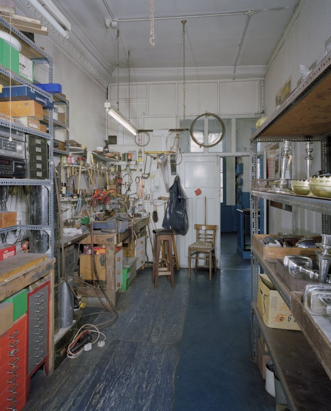 Interior. Ground floor. View of workshop from SE