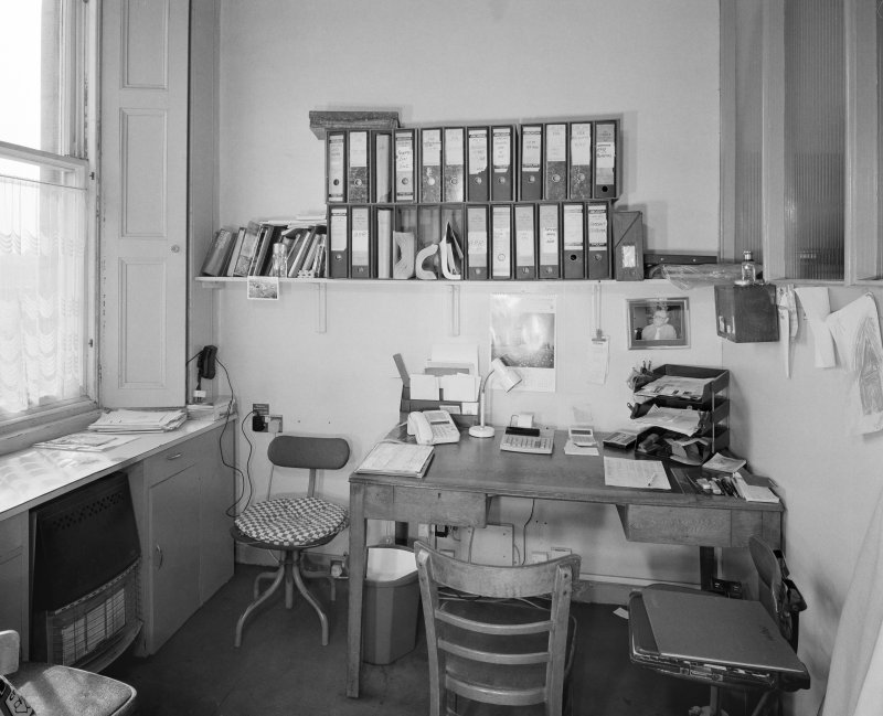Interior. Ground floor. View of office from NE