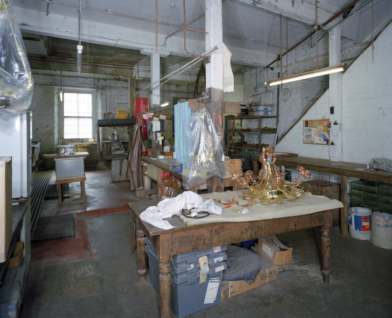 Interior. Lower ground floor. View of workshop from NW
