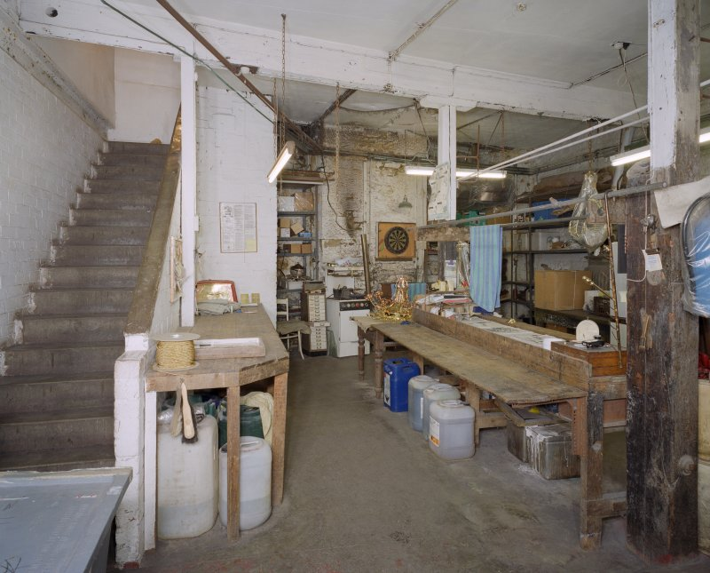 Interior. Lower ground floor. View of workshop from S