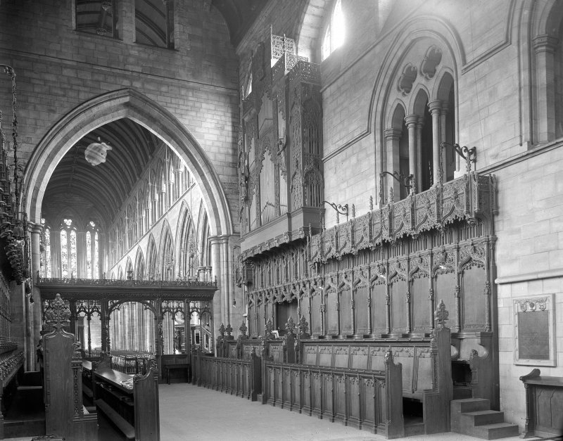 Interior. Choir, view of stalls and screen.