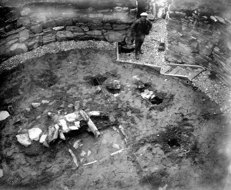 View of Dun Troddan broch interior showing hearth and postholes during excavation in 1910.