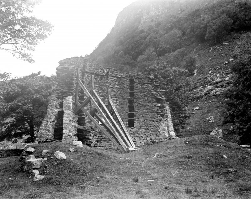 View taken from the SE, showing timber shoring bracing the interior of the wall.