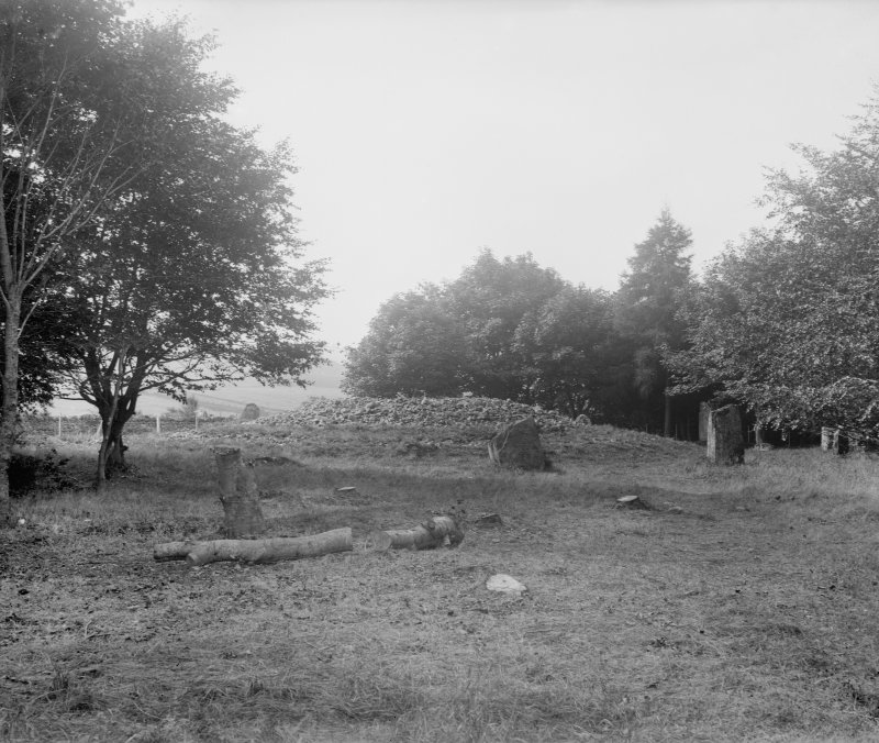 View of cairn and stone circle.