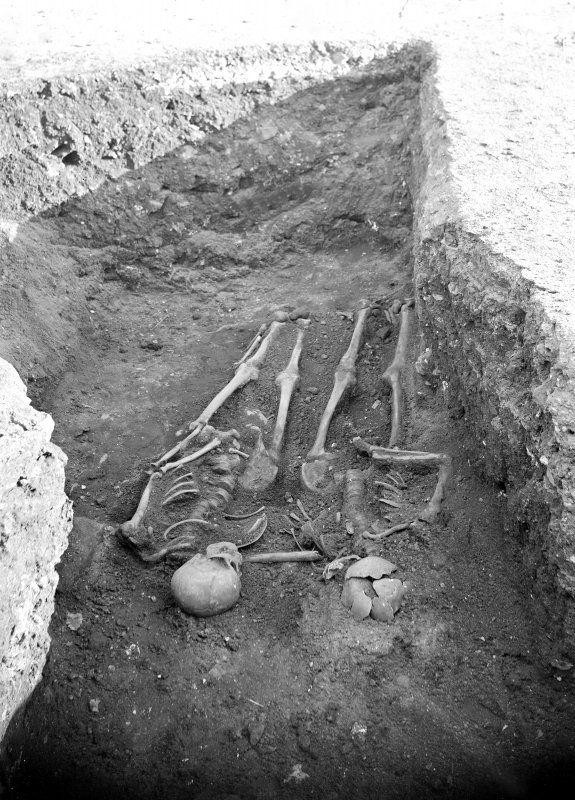 Photograph of two skeletons found in 1900s castle excavations