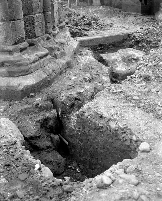 Interior. View of excavation at base of pier.