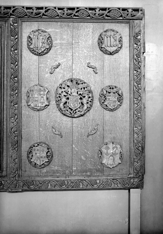 Detail of Beaton Panel studded with 7 carved bosses.