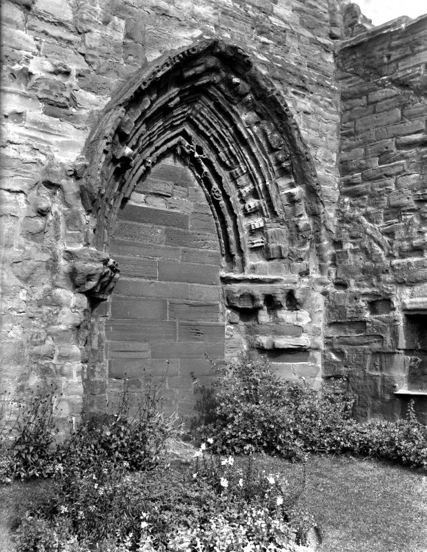 Historic photographic detail of doorway in wall of S aisle.
