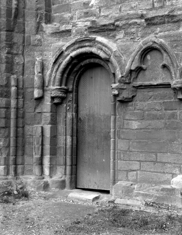 Historic photographic detail of doorway in SE angle of S transept.