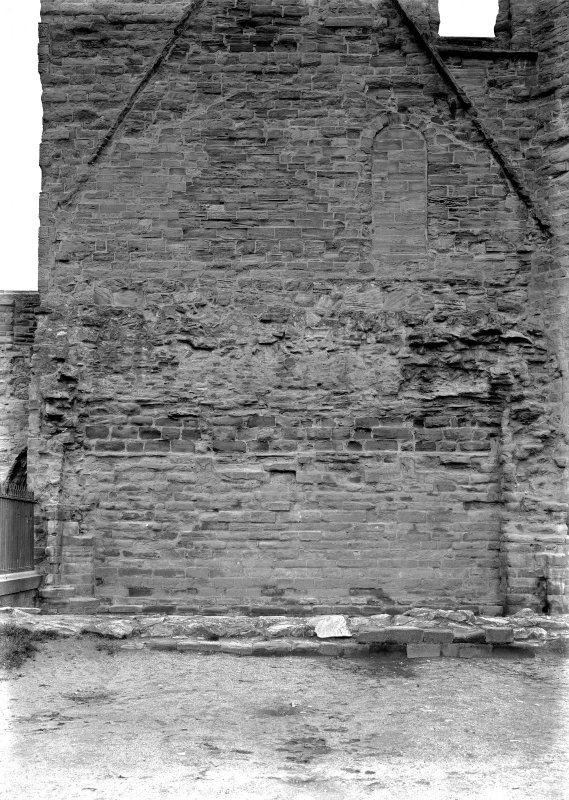 Historic photographic interior detail of wall of S transept showing scar lines of chapter house roof.