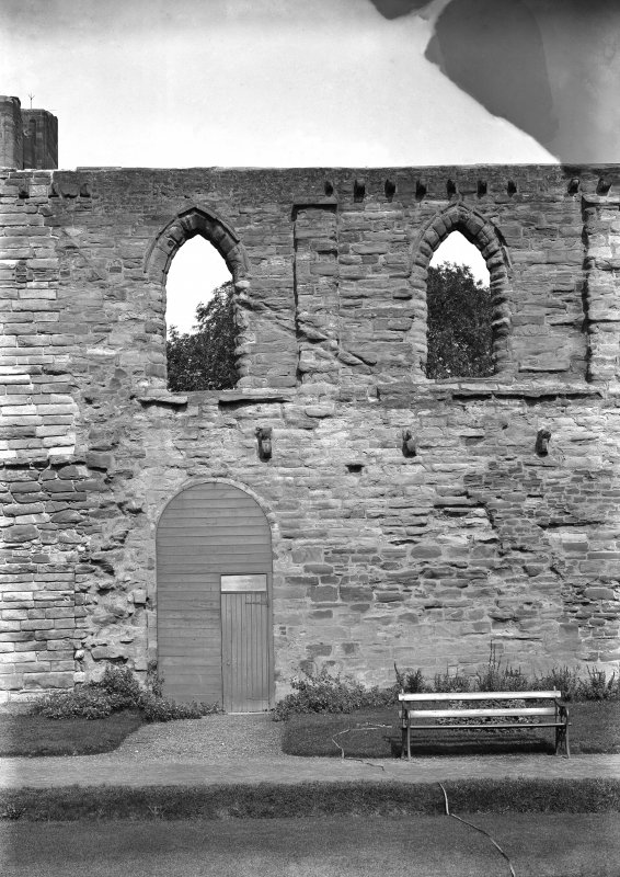 Historic photographic detail of doorway between cloister and S aisle.