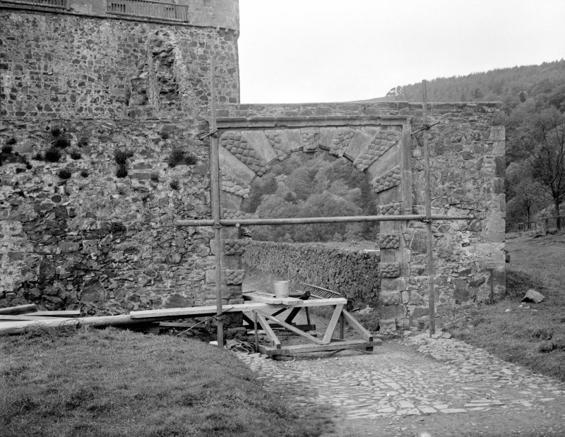 View of courtyard gateway during repair.
