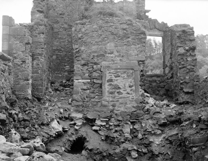 Interior. View of ruined portion of castle, showing fireplace.