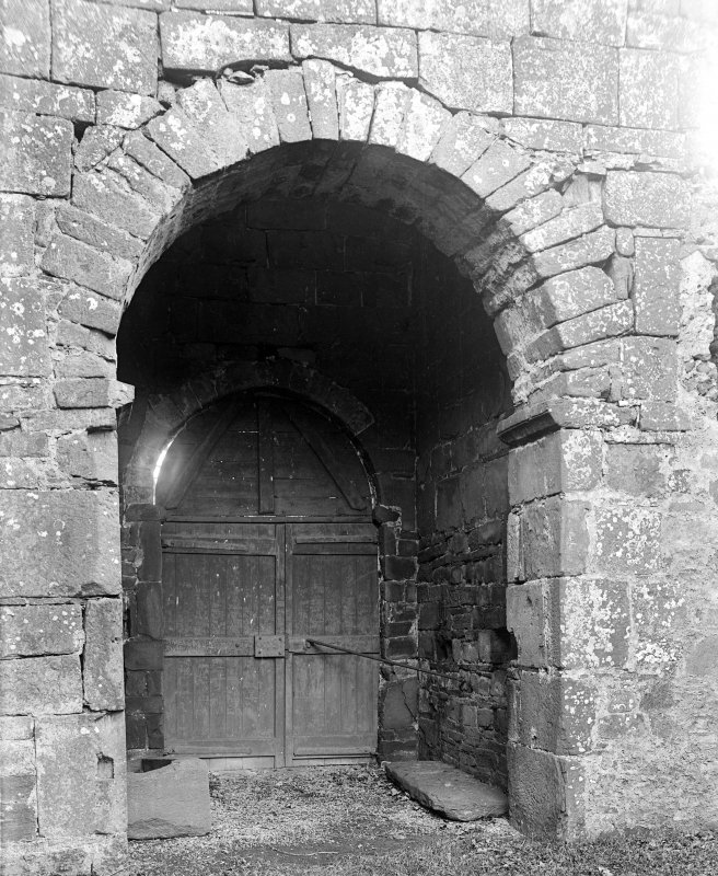 Interior. View of archway from tower to choir.