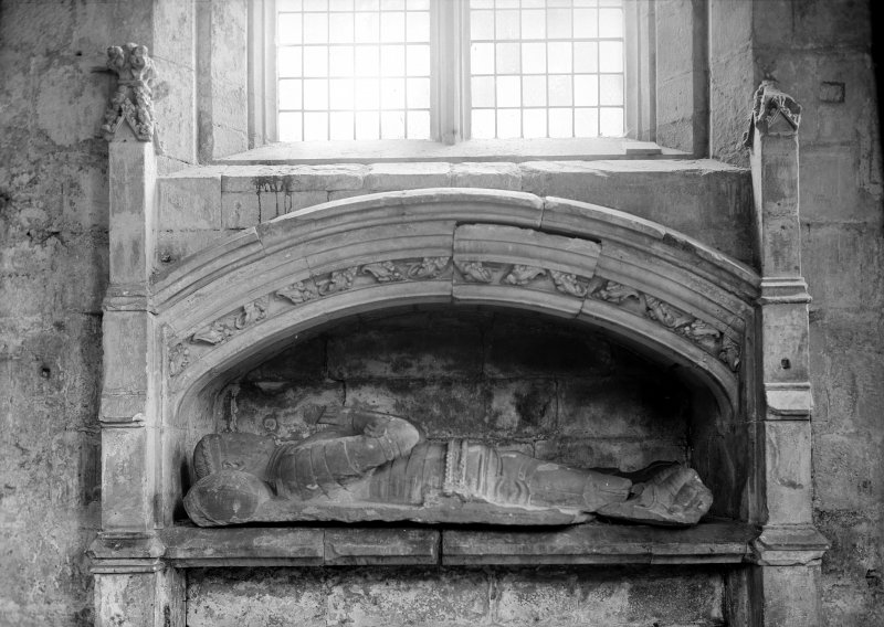 Interior. Detail of funerary monument in wall under NE window.