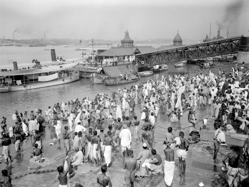 Crowded riverside with bathers and ferry near Chandpal Ghat, Kolkata.  The jetty collapsed in the 1950's.