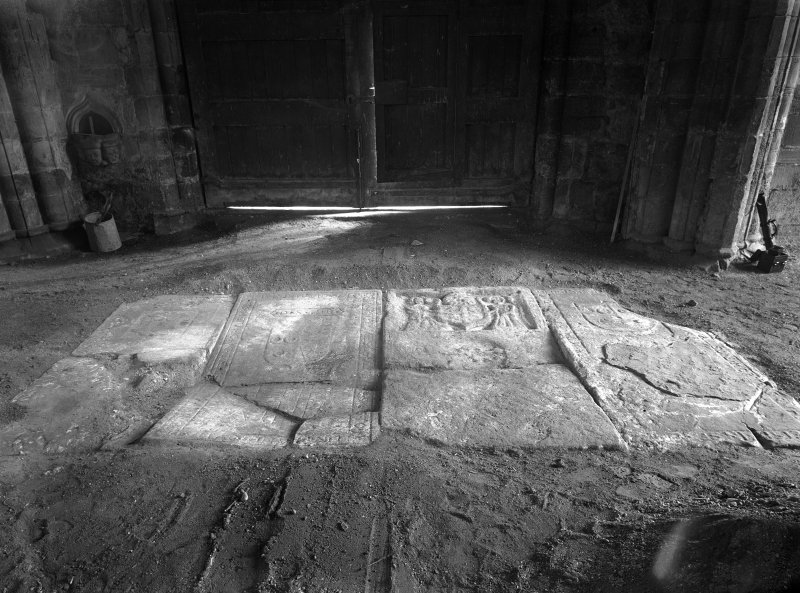 Interior. View of tomb slabs in pavement.