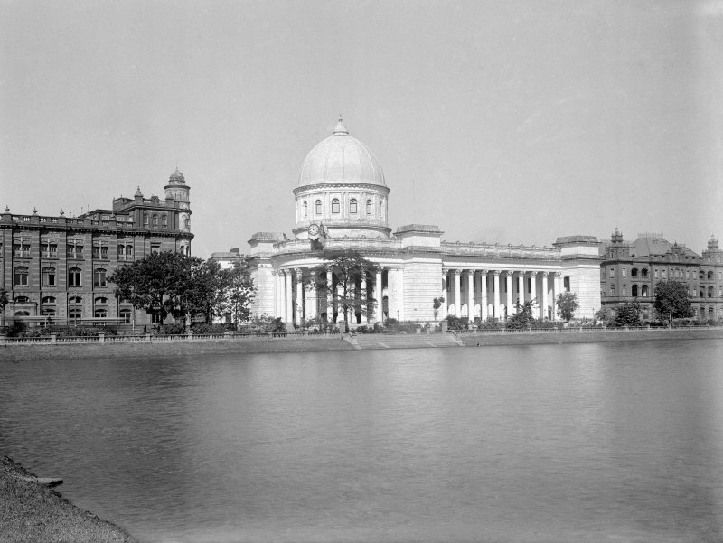 General Post Office seen across the Lal Dighi (water tank), with the Royal Insurance Buildings to the left and the Collectorate Buildings to the right, Kolkata.