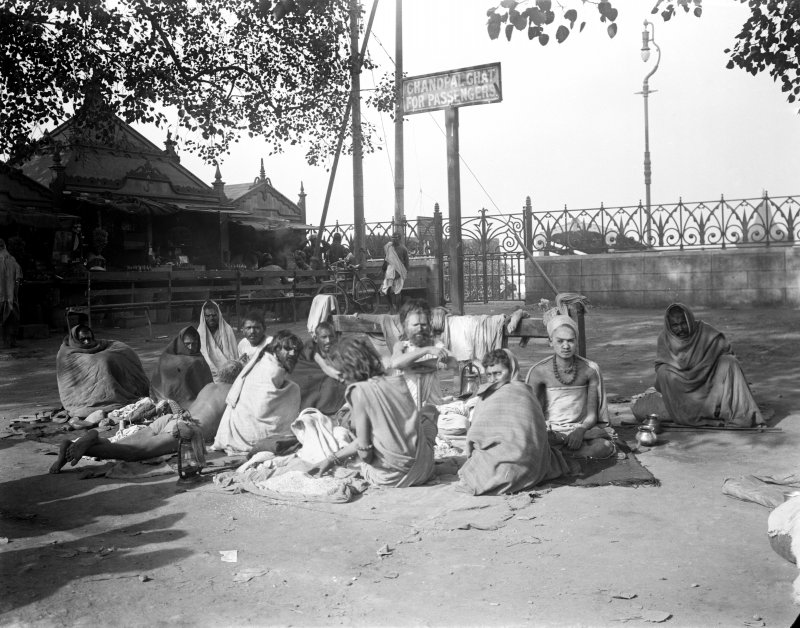Seated group of sadhus at Chandpal Ghat, Kolkata.