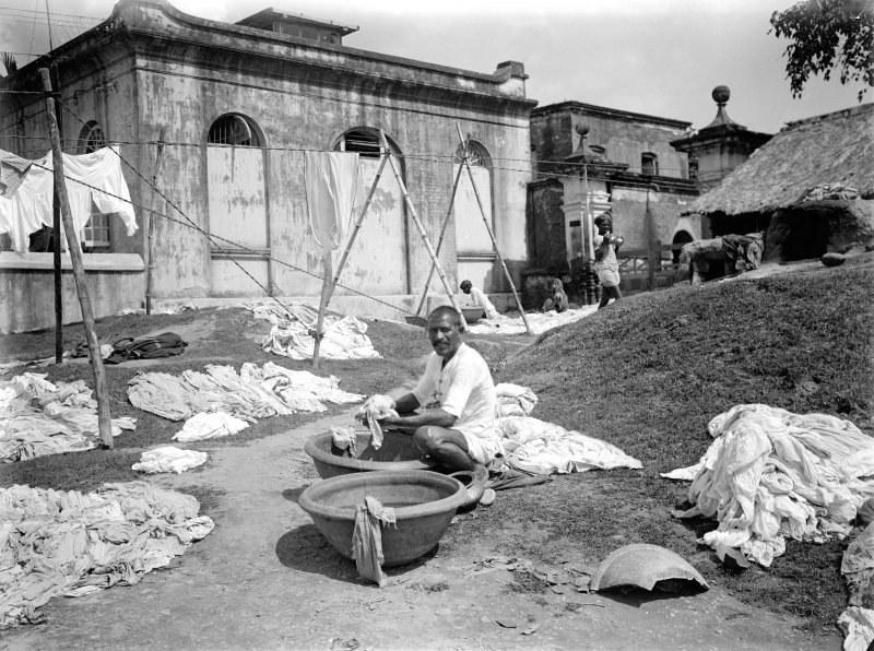 Washerman at a dhobi ghat.  Unknown location.
