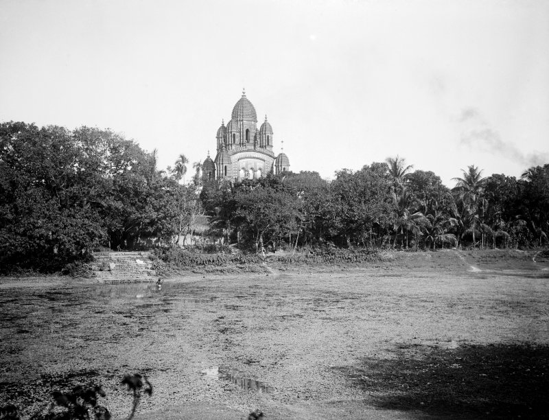 Temple from across a water tank, built in the traditional Bengali navaratna (nine jeweled) style.  Possibly Radhanath Temple, Bawali, a village 30 kms south west of Kolkata.