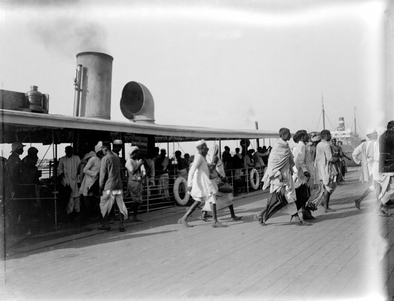 People disembarking from a river ferry at jetty, Kolkata.