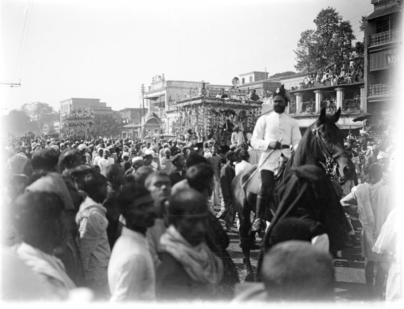 Muhurram procession with taziya through crowded street, Kolkata.