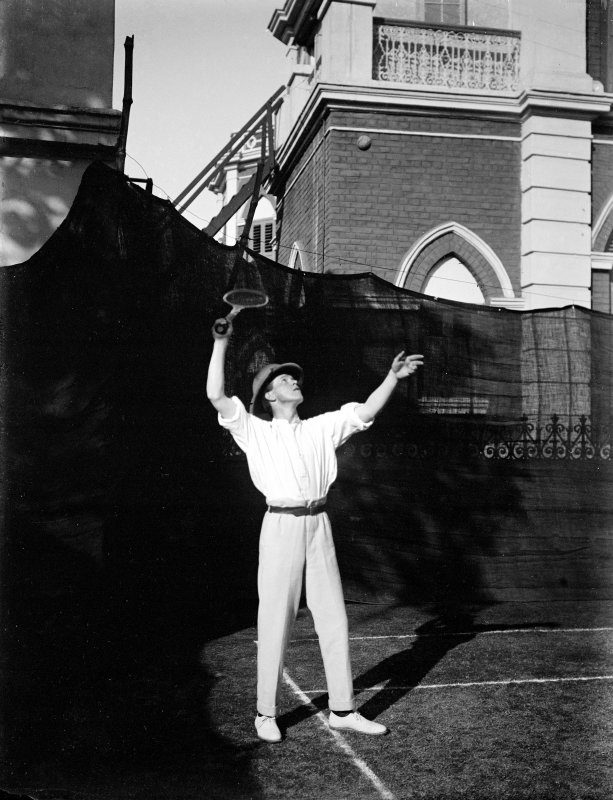 Unknown man playing tennis.  Unknown location.