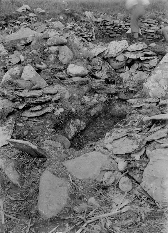 Eileach An Naoimh, Grave C. General view of grave partly under foundations in Southern graveyard.