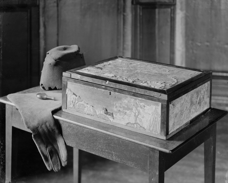 Interior-detail of decorated box (closed), gloves and remains of hat in Mary Queen of Scots' Bedroom in Holyrood Palace.