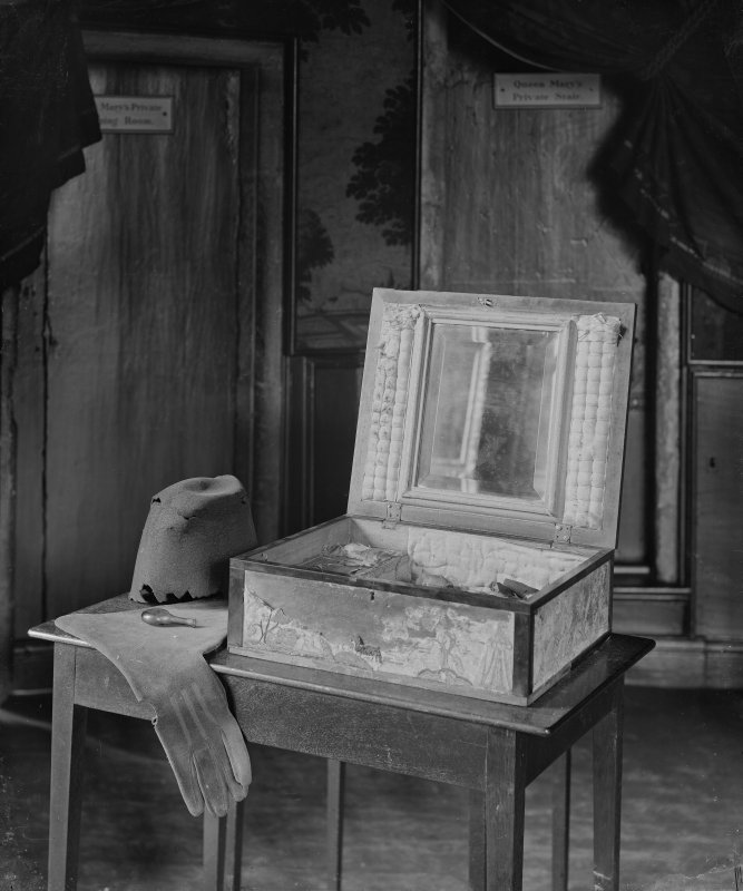 Interior-detail of decorated box (open), gloves and remains of hat in Mary Queen of Scots' Bedroom in Holyrood Palace.