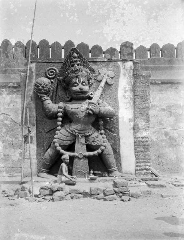 Statue (in semi relief) of Hanuman (now enclosed), at the south entrance (Horse Gate) to the Jagganath Temple, Puri, Orissa.