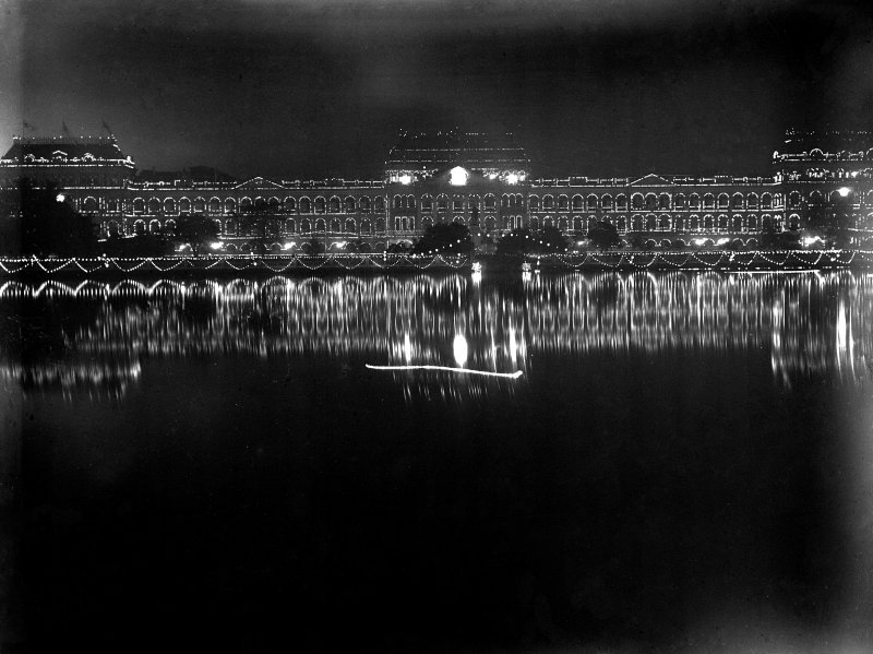The Writers Building, Kolkata from across the Lal Dighi tank at night, lit for the British royal visit.