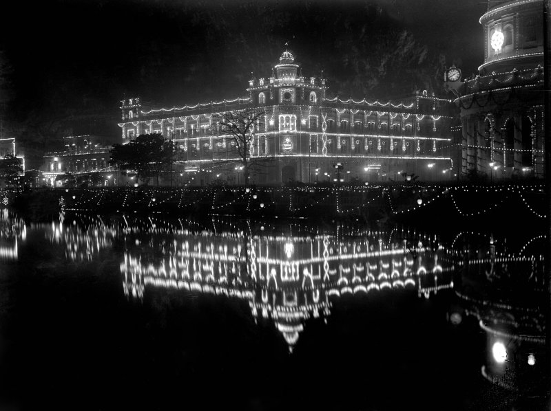 Royal Insurance Building, Kolkata from across the Lal Dighi tank at night, lit for the British royal visit.
