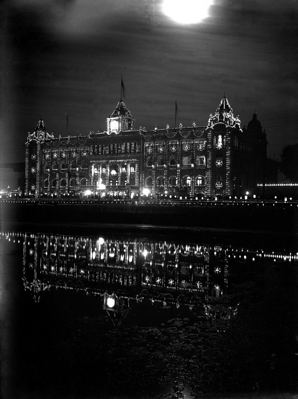 The 'new' Bengal Club, Chowringhee lit for British Royal visit.  This part of the club is now demolished, having been completed in 1908 by the architect J Vincent Esch (who was also supervising architect for the Victoria Memorial, Kolkata).