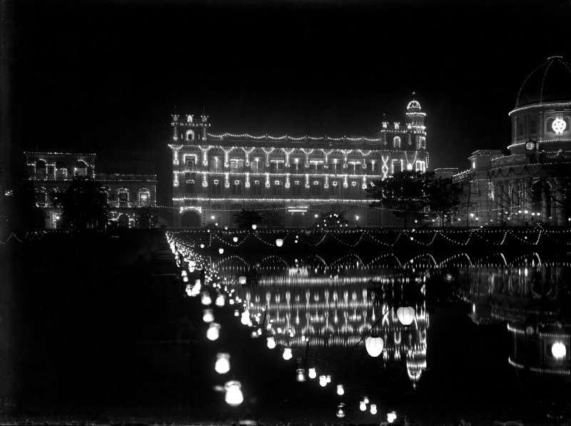 Royal Insurance Building, Kolkata from across the Lal Dighi tank, lit for the British royal visit.